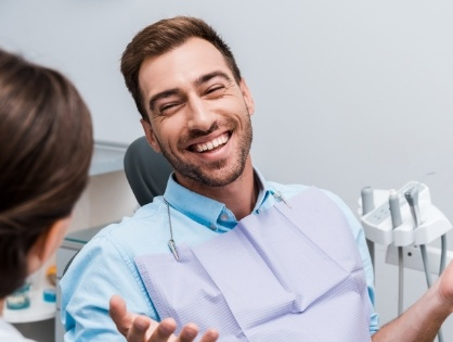 man laughing in exam chair