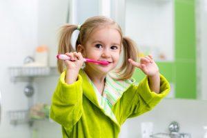 little girl with toothbrush